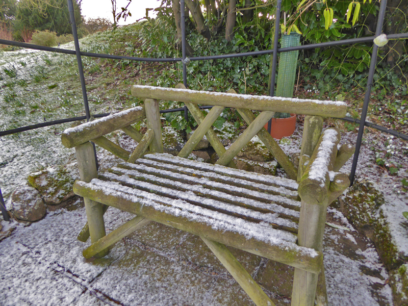 Wooden bench in the snow at Hodsock Priory